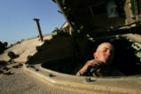 04/08/2005 Iraq-PFC Ron Huebner, 20, a Bradley driver with 3/3 ACR, shaves in his driver's seat at...