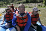 DLM1307  Lee Tom Jones, 25, center, smiles from ear to ear as he floats down the Colorado River...