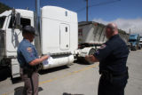 l to r:Colorado State Troopers  Ryan Byers (cq) and Mike Duncan of the Motor Carrier Safety Unit...