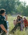 Family Members hug each other as as rescue wokers rescue a 28 Yr old man who plunged off a 200 Ft...