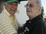 John Rossi (cq), left, greats Don Ciancio, at the Mary Ciancio Golf/Tennis Tournament, Tuesday...