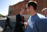As Mayor John Hickenlooper gets ready to leave, he shakes the hand of Andrew Sparks (cq) with...