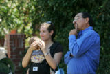 Joe Contreras, who owns the house next door (on the west side), talks with homeowner Christa...