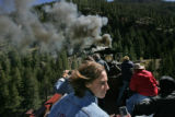 Diane Logan (CQ), of Georgetown, Colo., closes her eyes as smoke and steam bellow out of the...