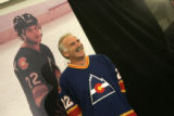 0029 Colorado Avalanche coach Joel Quenneville shows off an Avalanche jersey from his era  during...