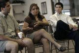 State Representative Michael Garcia (cq), left, listens to Gina Sandoval (cq) talk about her...