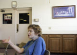 Aurora resident Barbara Hoover (cq), 55, expresses her concerns about healthcare during a meeting...