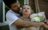 Graham Garlick talks to his daughter Marina Garlick, 3 about getting along with her brother, Seth,...