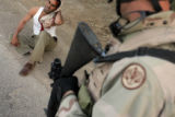 04/10/2005 Iraq-An Iraqi man, injured after a VBIED detonated next to a passing Humvee while he...