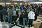 Travelers wait in massive lines to rebook new flights after theirs were cancelled due to a heavy...