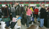 The line was more than three hours long at the Frontier ticket windows as travelers waited to...