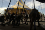 (DENVER, Colo., May 27, 2004) The workers put up the big top with a smaller tent behind.  Cirque...
