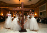 A group of ballet dancers place a cross in the middle of the room at the Father-Daughter Purity...