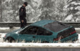 (EVERGREEN, Colo., April10, 2005) Todd Thompson works on clearing snow off the sidewalk in  down...
