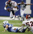 Dominique Foxworth leaps over Dallas Clark after an incomplete pass in the first quarter of the...