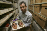 Chip Colwell-Chanthaphonh(cq), Curator of Anthropology, holds two Guatamala masks not acceptably...