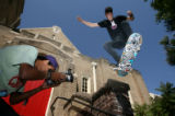 (from left) Whitney Wells (cq) videotapes his friend, Greg Harbour (cq), as he takes off from the...