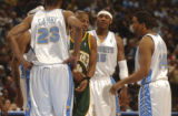 Denver, Colo., photo taken April 9, 2005-(left to right) Nuggets starters Dermarr Johnson, Marcus...