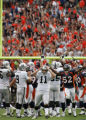 Denver Broncos linebacker Ian Gold, #52, celebrates a missed field goal by Oakland Raiders kicker...