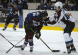 With his stick #48 Kyle Cumiskey (r) gives teammate #94 Ryan Smyth a shove at the Cadet Ice Arena...