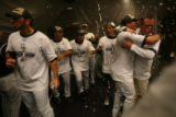 [ES1638] The Rockies celebrate in their clubhouse after their 9-8 victory in 13 innings. The...