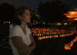 Keriba 'K' Neveau (cq) talks to other attendees during Second Wind's  candle light display at...
