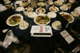 "A table of full of food and Bill Clinton's new book, ""Giving,"" wait for people to come..."