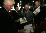 "Former President Bill Clinton signs copies of his new book, ""Giving,"" after speaking to..."