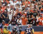 [JOE0311] Denver Broncos fans react to Broncos cornerback Champ Bailey's (34) interception in the...