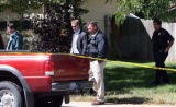Greeley Police Investigators at the scene on Monday September 17,2007  where  a double shooting...