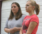 L to R: Tamara Strang (cq) and her daughter Chelsea Strang (cq) stand in front of their home...