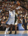 Denver, Colo., photo taken April 9, 2005- Nuggets forward, Carmelo Anthony (cq left) makes his way...