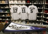 Rockies jerseys and pennants at the Sportsfan sports store on the 16th St. Mall in Denver Tuesday...