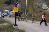 CODER102 - Rescuers head up the road from an Xcel Energy hydroelectric plant in which five...