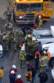 CODER105 - Rescue workers put on air tanks as they head into an Xcel Energy hydroelectric plant in...