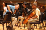 Peter Cooper (cq), Principal Oboe (on left) speaks with Eric Bertoluzzi (cq), section cello at the...