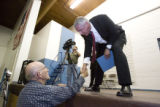 DLM1011  Robert Longwell, 81, of Greeley shakes the hand of Weld County District Attorney Ken Buck...