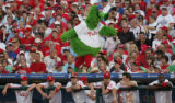 "[JOE0357]  Philadelphia Phillies mascot ""The Phanatic"" walks atop the Phillies dugout in..."