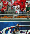 #5 Matt Holliday of the Rockies watches Pat Burrell's homer in the bottom of the 5th go into the...