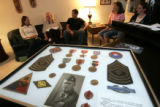 DLM1421  A frame containing an old photograph of Sgt. Don Haynie and his medals from his service...