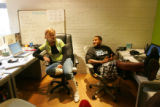 Anna Thompson,  (cq), left, director of operations for Beatsource.com, at her desk, and Francois...