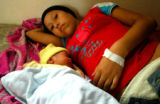 Ana Maritza Marcia, 16, rests inside a maternity center built by Doctors Without Borders several...