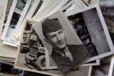 Portrait of Joe Weinmeier (cq), 81, taken in 1944 rests on top of a pile of old photographs,...