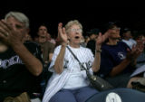 [ES0073] Colorado Rockies Lola Reinke (CQ), 82, of Denver, Colo., cheers on the Rockies from her...