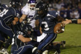 Columbines # 3 Orenzo Davis was torn up the field in this first quarter run at the Jefferson...