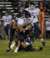 Columbines #88 Ben Tedford and #50 Curtis Cunningham  sacks Arvada's #10 Luke Campbell in the...
