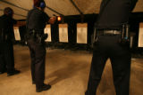 from left to right, Denver Police Officers, John Adsit, Colleen M. O'Dell and Robert Suthern draw...