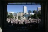 Denver Mayor John Hickenlooper welcomes and congratulates a diverse group of 610 local residents,...