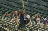 Jim Clark, of Grand Junction walks out with his broom in hand after the Colorado Rockies against...