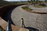 DLM1745  Kirsten Kreiling, a member of the Columbine Memorial Committee, walks around the outer...